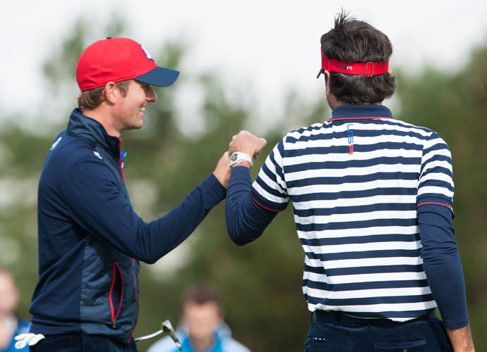 Bubba Watson bumps fist with teammate (and potential playing partner) Webb Simpson.