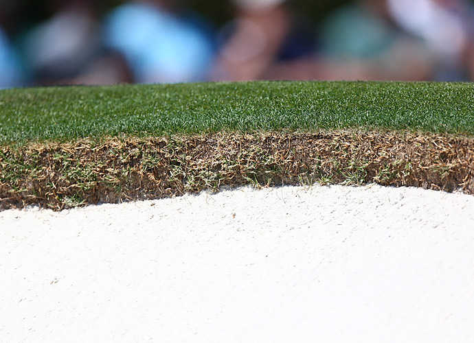 A close-up look at the insanely well-manicured bunker edges at Augusta National.