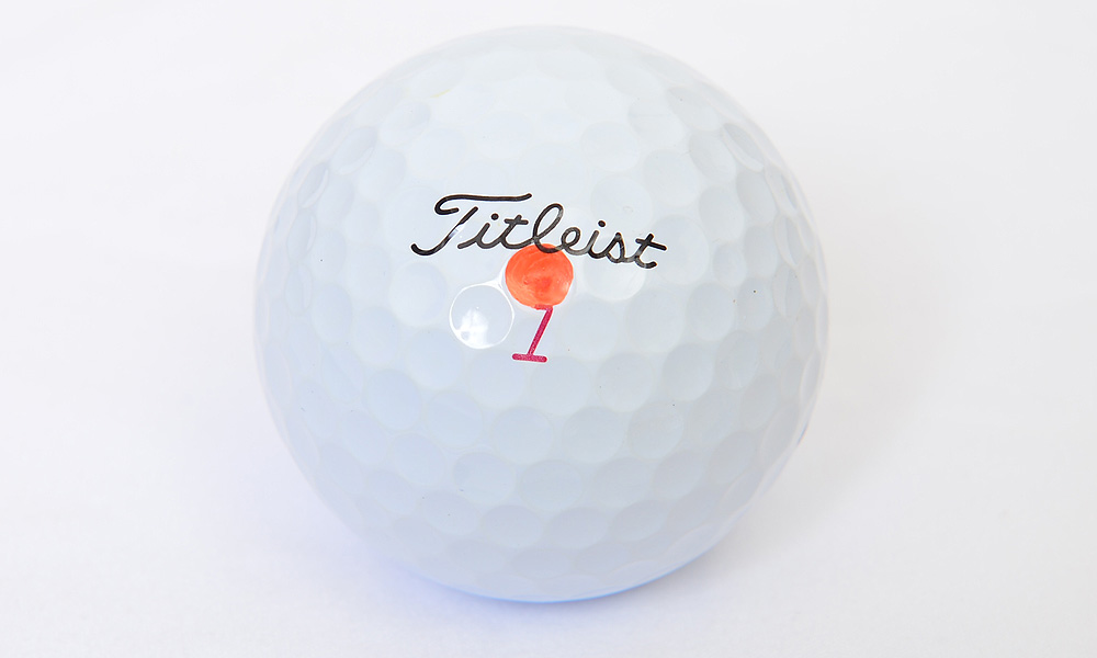 Byrd uses a Titleist Pro V1x and marks it with a single orange dot.