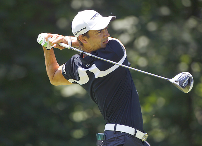 Camilo Villegas fired a seven-under 64 to tie for the lead in the first round at TPC Deere Run.