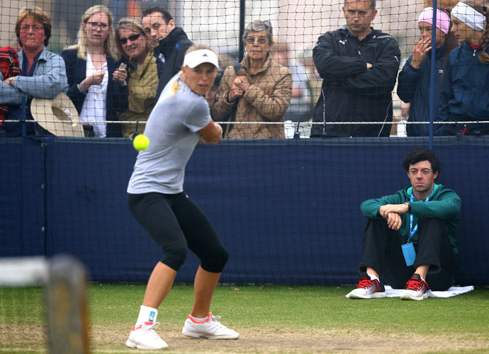 June 20, 2013: Rory watches Caroline warm up before competing at the AEGON International tennis tournament at Devonshire Park in England.