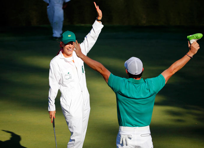 April 9, 2014: Wozniacki and McIlroy celebrate after Caroline rolled in a long putt during the Par 3 Contest.