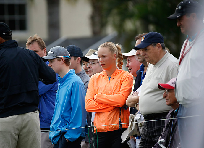 Tennis star Caroline Wozniacki, McIlroy's fiancee, watched from the gallery.
