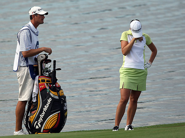 There was nothing for Nicole Castrale's caddie, and husband, to say after she hit into the water on 18 Saturday and made bogey. Her blunder dropped her out of eighth place and gave Christina Kim the final spot in Sunday's action.