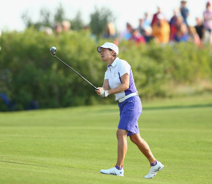 Catriona Matthew of Scotland hits her second shot on the 1st hole.