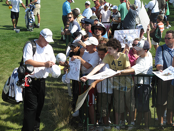 was the runner-up at the 2003 PGA Championship at Oak Hill. On Monday he stopped to sign some autographs while carrying his bag.