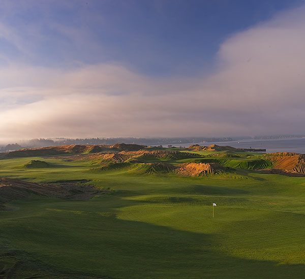 "Best New Course of the Year                           Chambers Bay Golf Course                           University Place, Wash.                           7,585 yards, par 72                           Green fee: $65-$150                           877-29-LINKS, chambersbaygolf.com                           At Chambers Bay the visuals scream                           Ireland: giant sand dunes, rumpled                           fairways, stunning sea views, and                           unpredictable weather. But this superb                           new course is almost 5,000 miles west                           of Ballybunion, atop an old gravel mine                           about an hour south of Seattle, Wash.                           This Robert Trent Jones II-designed                           municipal track is a walkers' only feast                           for the eyes, and a relentless test of both                           swing and stamina. Call it Bethpage                           Black-by-the-Sea.                                                       The eye candy commences right at                           the 1st hole, with a 50-foot-high dune to                           the right and the backdrop of Puget                           Sound. It only gets better from there.                           Highlights include the par-4 5th, called                           ""Free Fall,"" which plummets 80 feet                           from tee to landing area and culminates                           in two separate greens—150 yards apart.                           The farther green is receptive to a lowrunning                           approach, while the closer one                           is fiercely guarded by sand. The dearth                           of forced carries means Chambers                           Bay is playable for all, although a                           memorable exception to that is the                           jaw-dropping par-3 9th, its wavy potato                           chip-contoured green perched on the                           far side of a ravine.                           Chambers Bay earns the greatest                           compliment it's possible to bestow on a                           new course: By the time your caddie                           replaces the flag at 18, all you can think                           about is repeating the journey."