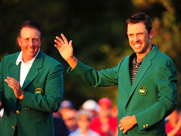 collected the most noteworthy fashion item of the 75th Masters: a plain, classic, brass-buttoned green blazer with championship crest on the display pocket. Last year's champion, Phil Mickelson, helped him put it on.