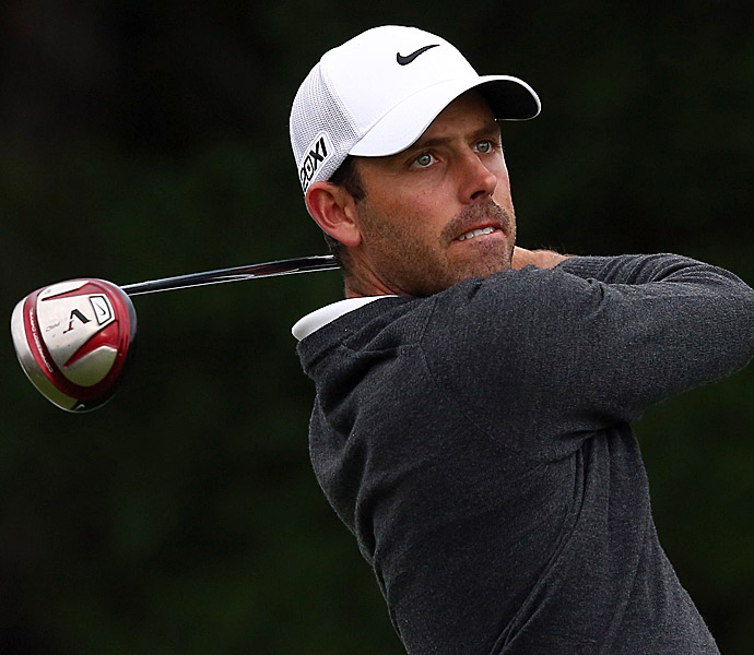 2011 Masters champ Charl Schwartzel was in second after a 63.