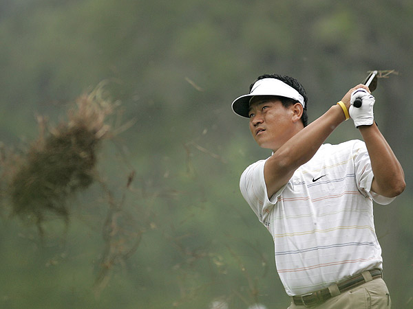 Korea's K.J. Choi brought up some serious sod with this shot Thursday at the TPC Sawgrass. The world's 30th ranked player, Choi shot a one-under-par 71 in blustery conditions.                                                      • See K.J. Choi's season stats and results