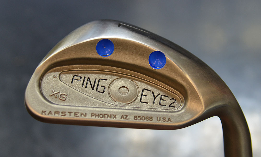 This Ping Eye2 XG wedge was made for Chris DiMarco. Two holes were drilled into the bounce to reduce weight and then painted Florida Gator blue.