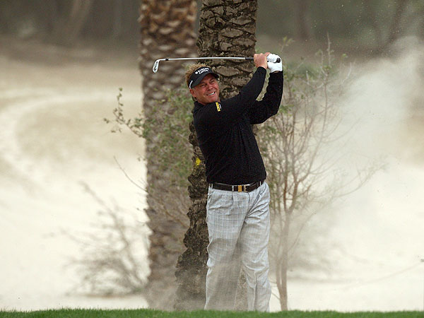 Northern Ireland's Darren Clarke battled the wind all day, but he missed the cut after shooting 75.