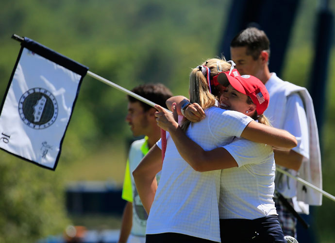 Cristie Kerr of the United States hugs playing partner Lexi Thompson after defeating Spain in the second round.