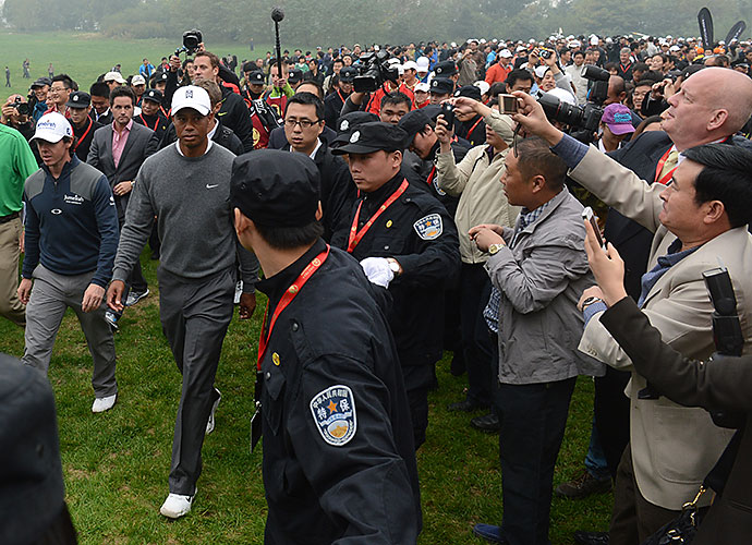"The first Tiger-Rory matchup was 12 months ago, also in China, at the Duel at Jinsha Lake. McIlroy started quickly, with two birdies in three holes and led by two at the turn. A chip-in birdie by Woods at the par-3 12th brought him within one. According to AFP, McIlroy said he had ""never seen so many people following one match."""