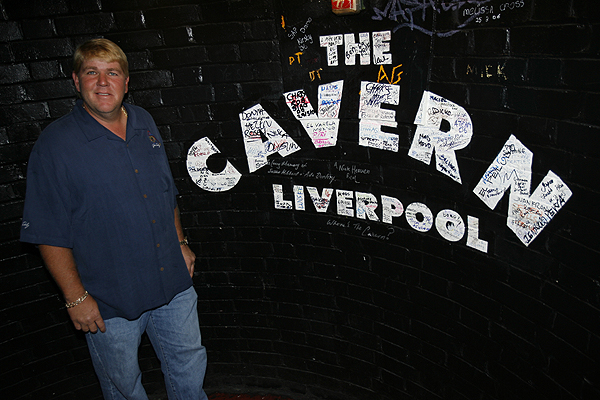Surrounded by pictures of The Beatles, John Daly played guitar at The Cavern Club in Liverpool before the British Open in 2006.
