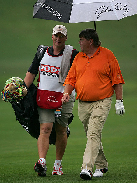 After Thursday's rain delay, Jon Gruden, coach of the Tampa Bay Buccaneers, caddied for John Daly.