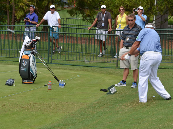 Darren Clarke hit several shots on the range Tuesday from a downhill lie.