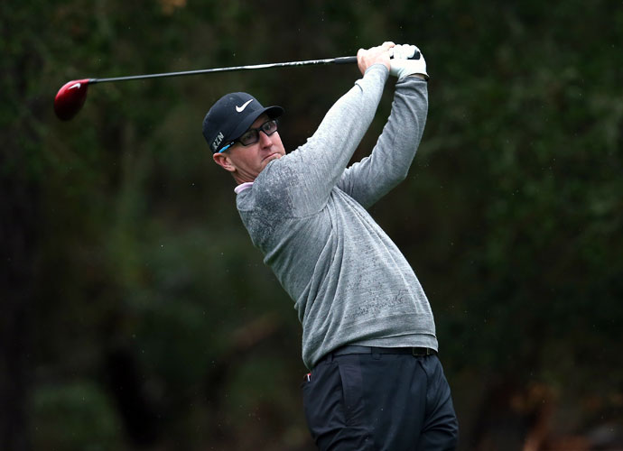 David Duval hits a tee shot on the eighth hole in the second round. Duval shot 68 at Spyglass Hill and is -4 entering the weekend.