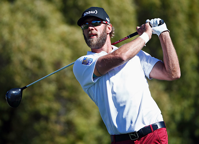 Five back nine birdies helped Canada's Graham DeLaet surge ten spots up the leaderboard and finished tied for second with Bubba Watson.