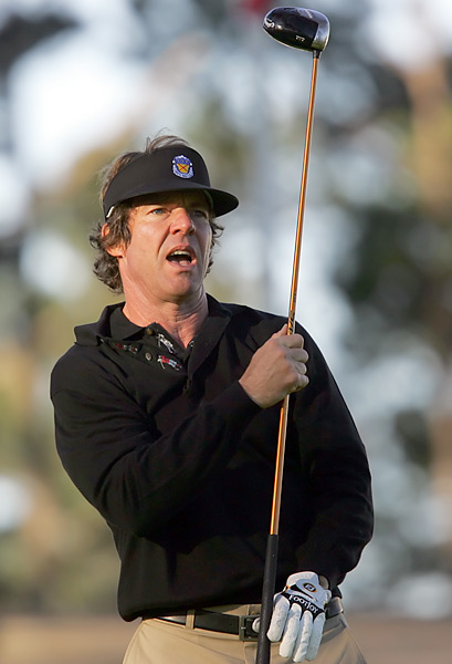 Actor Dennis Quaid watches his tee shot off the tenth tee at Spyglass Hill golf course during the second round in 2006.
