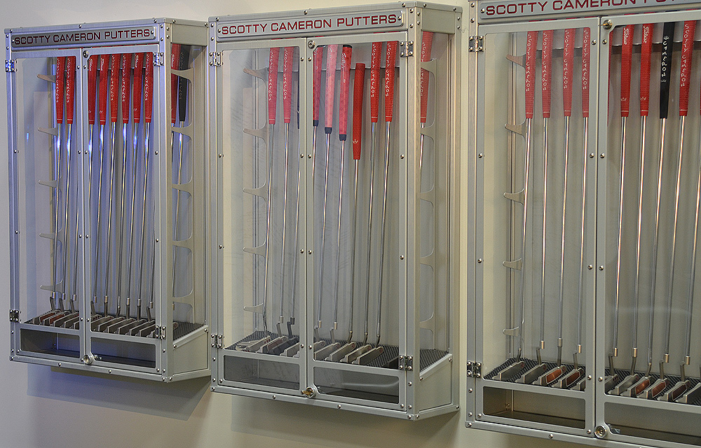 Along the walls of the putting studio are several cases that hold unique putters, prototypes and special clubs.