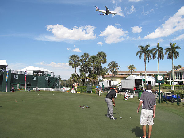 As the game's best players hone their putting, jets buzz over their heads before landing at nearby Miami International airport.