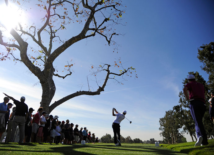 Dustin Johnson rips a drive from the third tee during the first round of the 2014 Northern Trust Open at Riviera Country Club in Pacific Palisades, Calif. Johnson shot a 5-under 66 to lead by one after the first round.