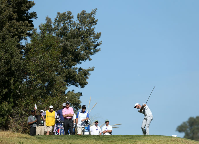 Dustin Johnson hits a tee shot on the fifth hole in the second round.