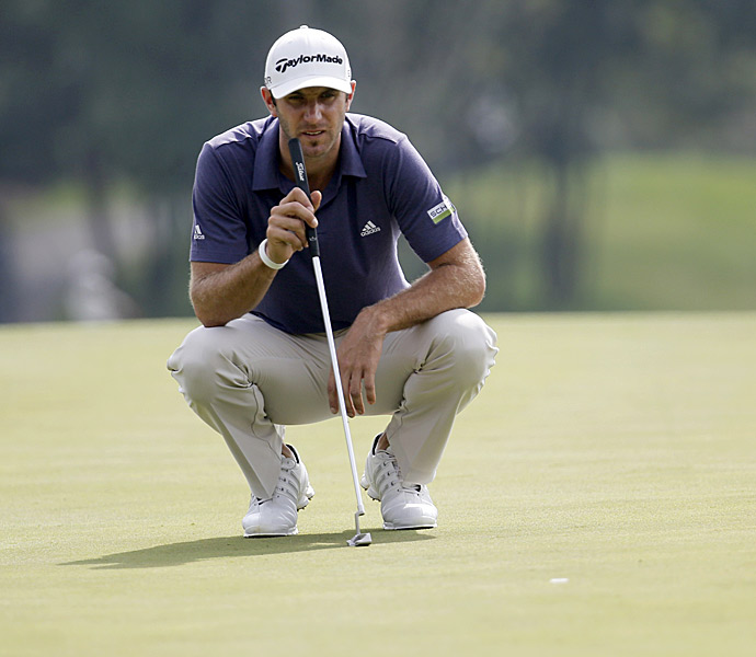 Dustin Johnson shot a course-record nine-under 63 in the second round to take a five-shot lead.