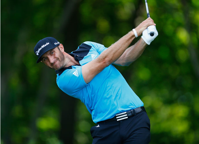 Dustin Johnson watches his tee shot on the 12th hole.
