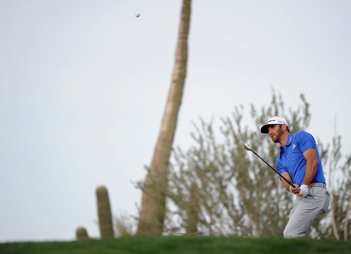 Dustin Johnson chips onto the first green. He lost, 4 and 3, to Peter Hanson.