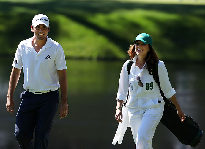 Jason and Ellie walk Augusta National during the par-3 contest prior to the 2011 Masters.