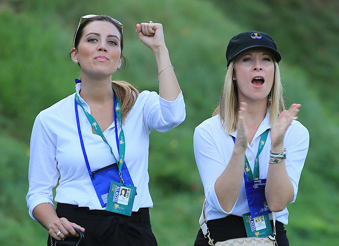 Ellie Day, left, and Ruby DeLaet cheer on the Presidents Cup International Team at Muirfield Village in Dublin, Ohio. Their husbands, Jason and Graham, were 2-1-1 in four matches as playing partners.