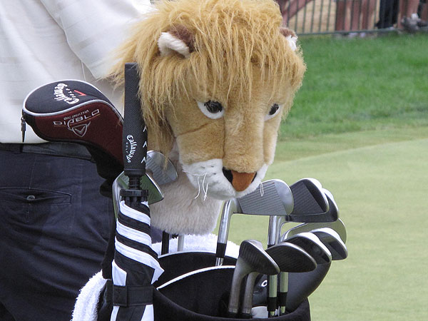 is not only a three-time major winner, he also owns a course design business, a winery and a safari company in his native South Africa. A lion guards his clubs.