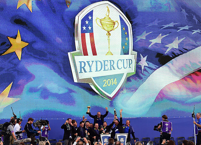 The European squad celebrates after receiving the Ryder Cup trophy.