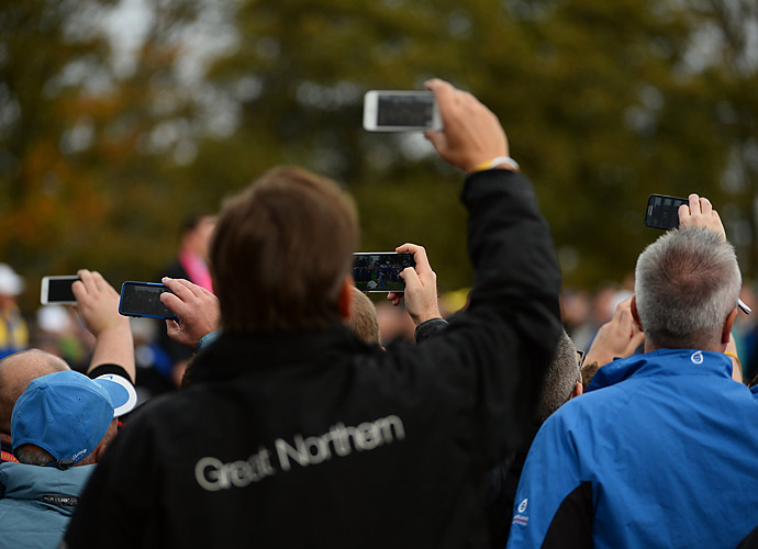 Amateur photographers hustled to get snapshots of their favorite players on Sunday.