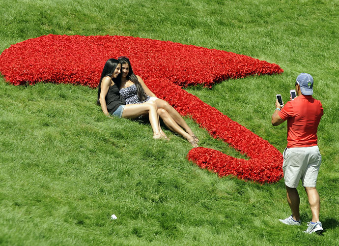 Two fans have their picture taken on the 18th hole.