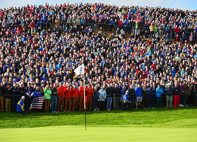 Large groups of spectators gathered around the greens on the rolling terrain at Gleneagles.