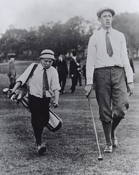 Eddie Lowery                       Perhaps no caddie photo is more well-known, especially one in which the caddie's name is generally forgotten. Francis Ouimet was the 20-year-old amateur that triumphed in the 1913 U.S. Open, now more than a century ago. However, his caddie, Lowery, was half his age and size, but the duo finished the playoff five strokes better than runner-up Harry Vardon.