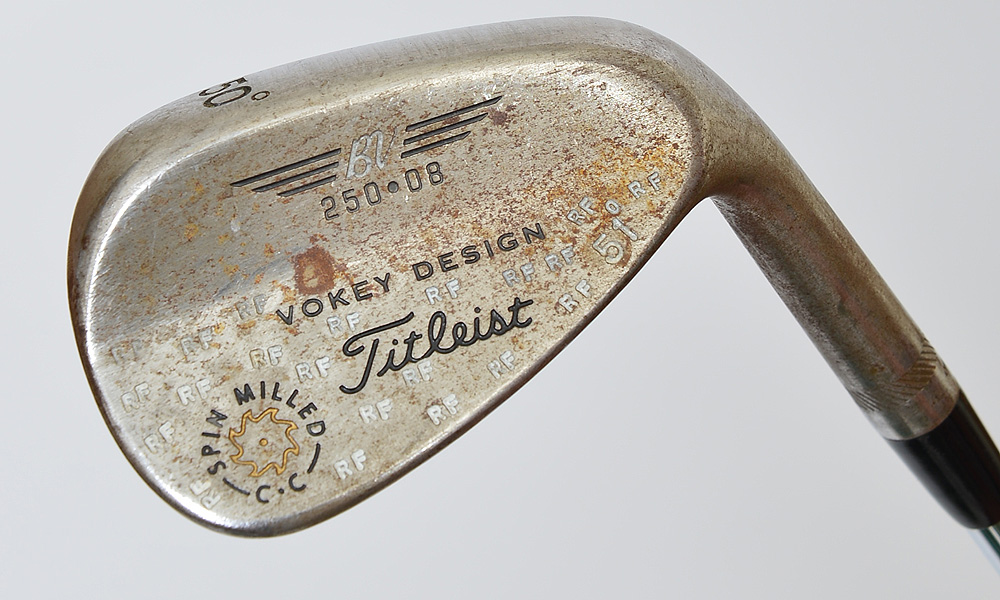 All of Fowler's wedges, including his Titleist Vokey Design Spin Milled (50°) gap wedge have been heavily stamped. Again, this club was bent 1° to give it a lot of 51°.