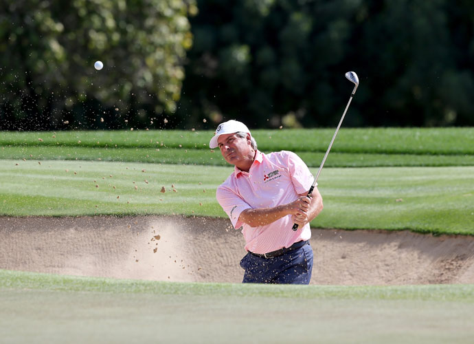 Fred Couples blasts out of a bunker during the Champions Challenge in Dubai.