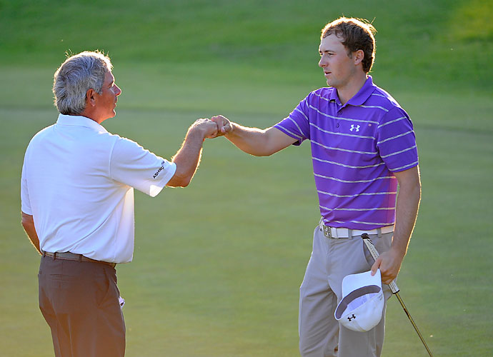 Fred Couples and Jordan Spieth fist bump on the 18th in the first round. Couples and Spieth both shot 1-over 72s.