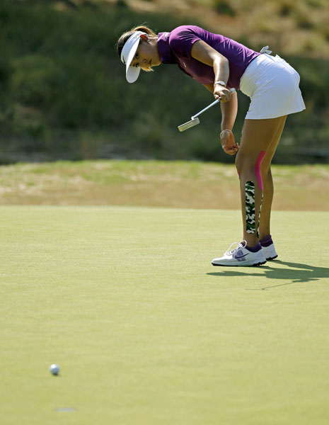 Michelle Wie misses a birdie putt on the 16th hole. She made three birdies and a bogey in her round of 68.