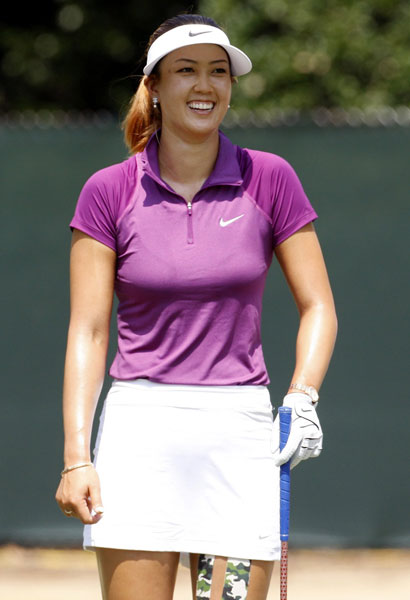Michelle Wie laughs before teeing off on the third hole. Wie had plenty of reasons to smile as she charged into the lead with her second consecutive 68. She'll begin the third round three 4-under, shots ahead of Lexi Thompson.