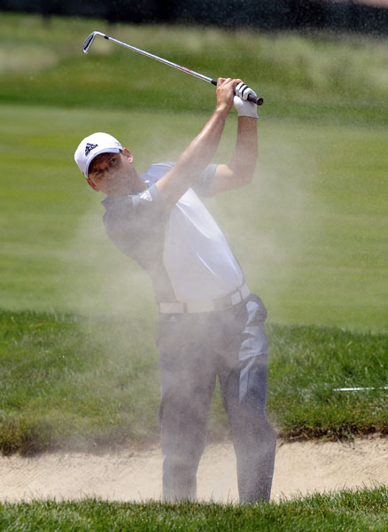 Sergio Garcia hits out of a fairway bunker on the seventh hole. Sergio shot 69 and was -6, five shots off the pace.