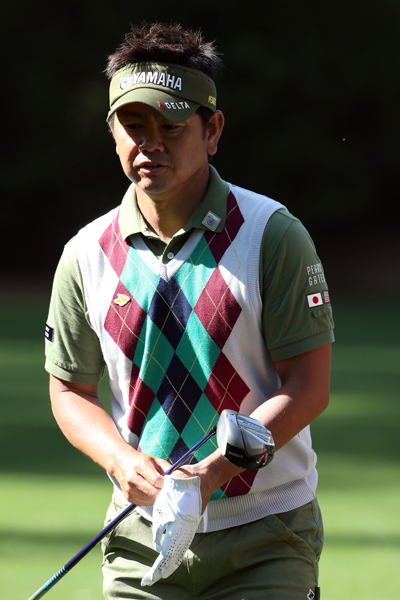 WORST: HIROYUKI FUJITA                           Fujita's argyle vest is lovely on its own. Unfortunately, he decided to pair it with an olive polo, hat and pants combo, which detracts from the colorful diamond print rather than enhancing it. This look could have been easily salvaged with a navy blue polo, white pants and a white hat.