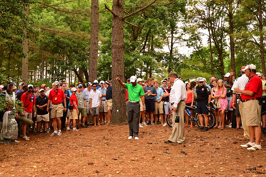 Woods received a bizarre free drop on the fifth hole after a spectator claimed he saw Woods's ball roll along the ground before it disappeared. Woods was given free relief because it was determined that a fan must have picked up the ball.