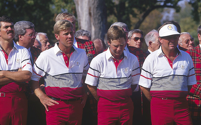 Ruderman says... How can we make our already high-waisted red pants look even more high-waisted? That's what I imagine the USA Team asking themselves before slipping into these color-block polos with red cummerbund-like panels at the waist.