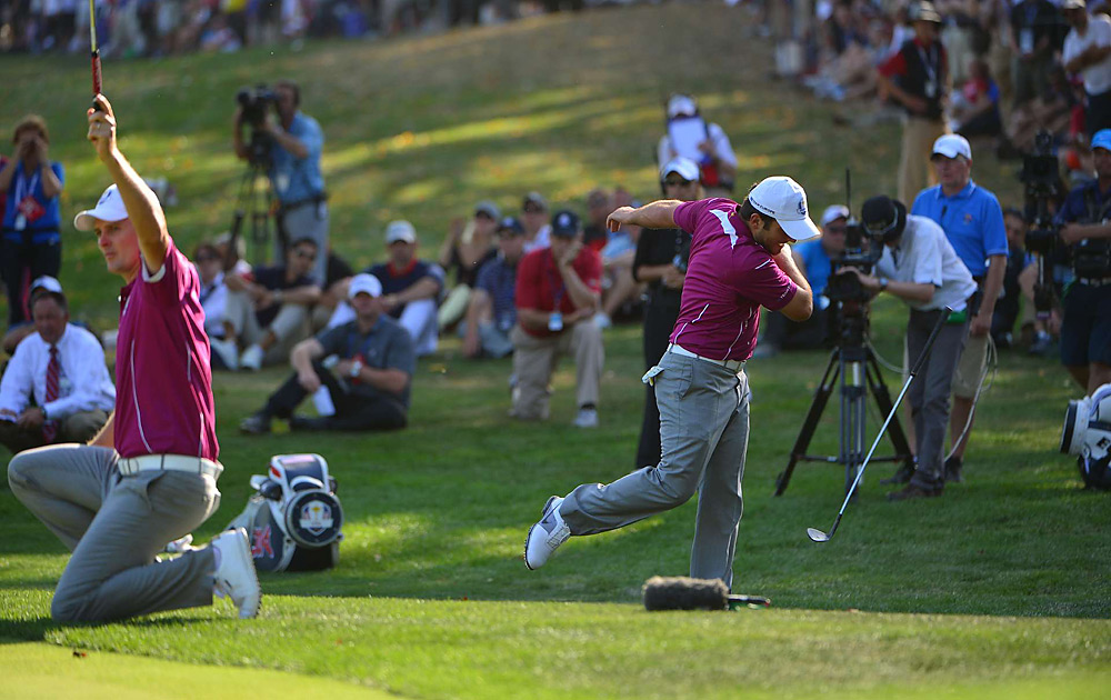 Francesco Molinari reacted with disgust when this chip shot failed to drop into the cup after hanging on the lip. He and Justin Rose lost to Webb Simpson and Bubba Watson 5 and 4 Saturday afternoon.