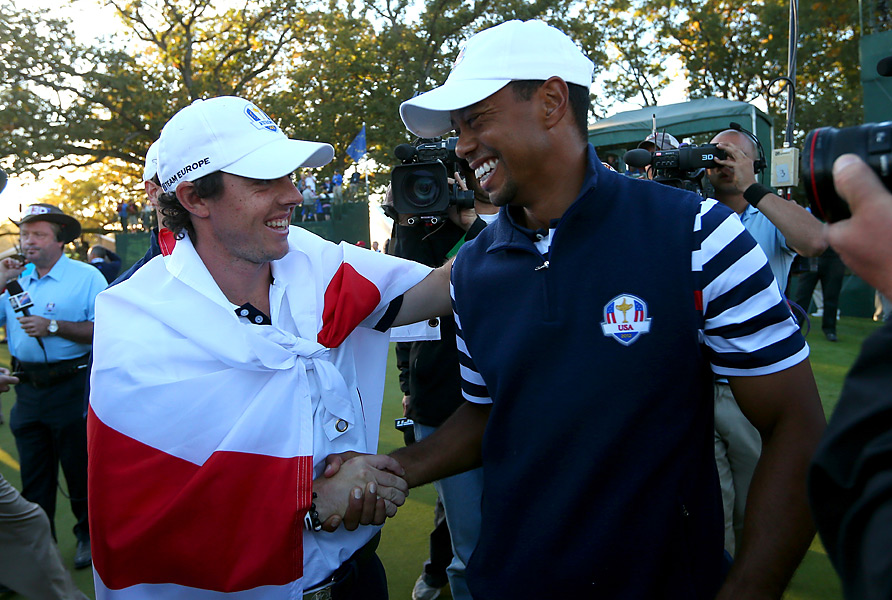 McIlroy and Woods never went head-to-head in a match at the 2012 Ryder Cup, but they shared a light-hearted moment after McIlroy's European team rallied in Sunday's singles matches to win the Cup by one point.